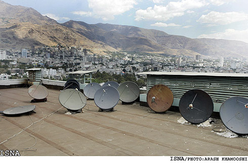 satellite dishes on the rooftop of a building in Tehran