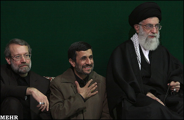 Parliament Speaker Ali Larijani (L), President Mahmoud Ahmadinejad (C) and Supreme Leader Ali Khamanei