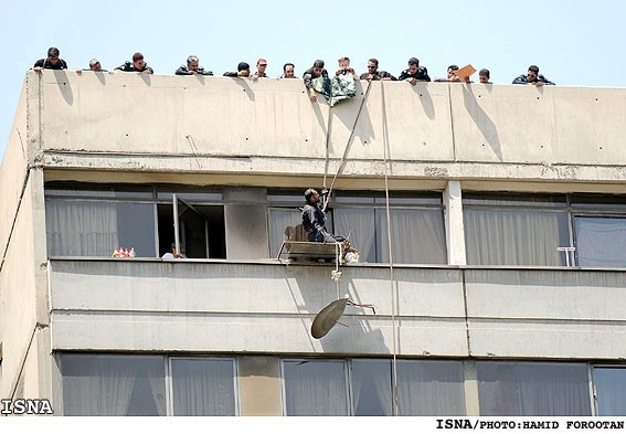 Photos: Iranian police destroying satellite dishes