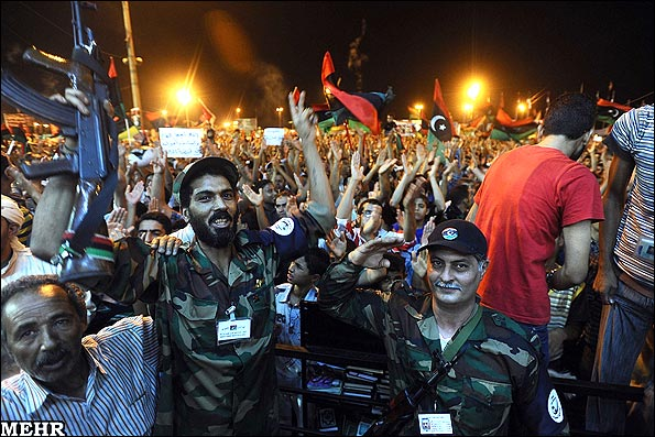 Victorious Libyan opposition fighters among the cheering crowd