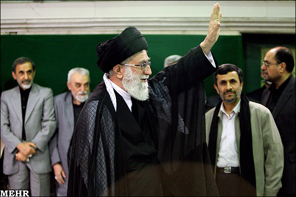 Supreme Leader Ali Khamenei (L) with President Mahmoud Ahmadinejad in the background
