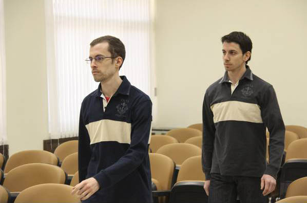 Shane Bauer and Josh Fattal in prison uniforms