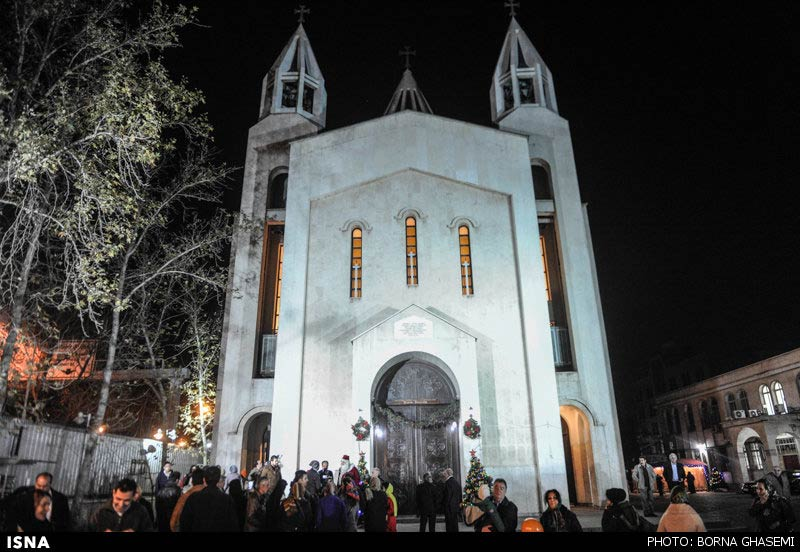 Photos iranian christians mark new year 2014 at sarkis church in tehran the new year 2014 during the ceremony special prayers were said and candles were lit this was also a chance for some to pose with the santa voltagebd Image collections