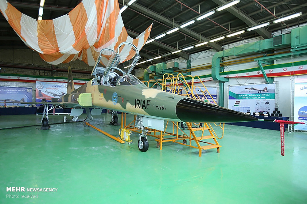 Eyeing US, Iran says to boost military might, unveils new fighter jet